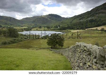 landscape with lake, lake district, uk - stock photo