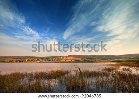 landscape with laker and cloudy sky - stock photo