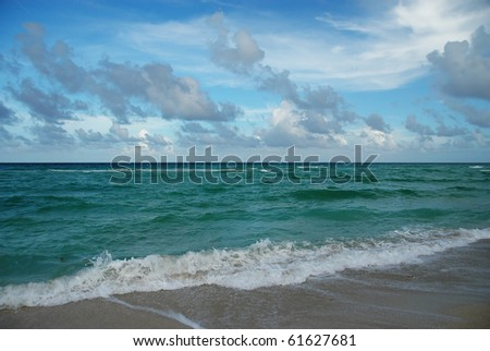 Landscape with low clouds above Atlantic ocean and breaking waves - stock photo