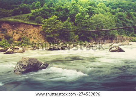 Landscape with mountain river flowing over rocks at summer. Filtered image:cross processed vintage effect.  - stock photo