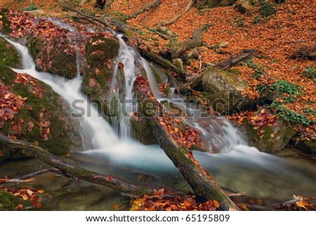 landscape with mountain stream in autumn forest - stock photo