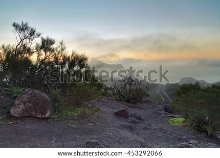 Landscape with mountains covered with clouds in sunset lights. Tenerife, Canary Islands, Spain  - stock photo