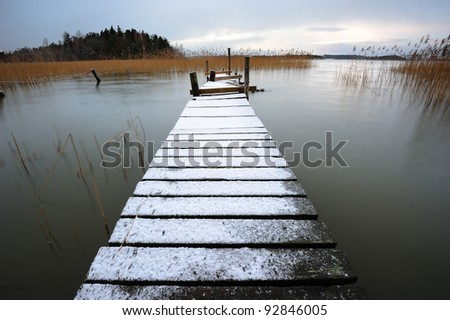 Landscape with pier in winter - stock photo