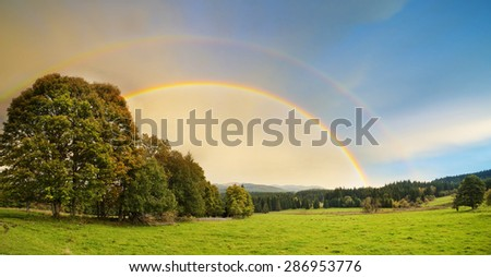 landscape with rainbow - stock photo