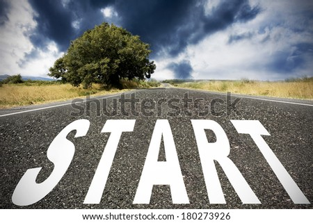 landscape with road and the word out in the foreground - stock photo