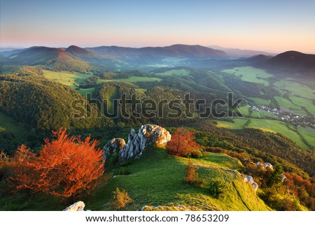 Landscape with rocky mountains at sunset - stock photo