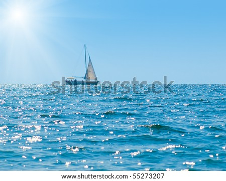 landscape with sailboat and bright sun