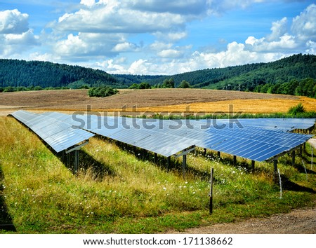 Landscape with solar energy field at sunny summer day - stock photo