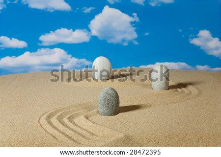 Landscape with stones on sky background
