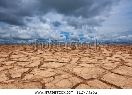 landscape with storm clouds and dry field - stock photo