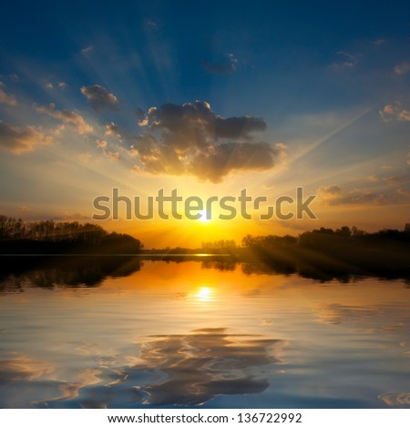 landscape with sunset over lake - stock photo