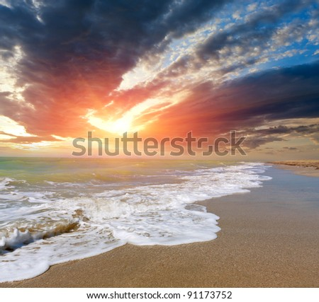 Landscape with sunset over sea - stock photo