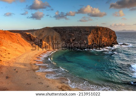 Landscape with the famous Papagayo Beach on the Lanzarote Island in the Canary Islands Archipelago, Spain at sunset time. - stock photo