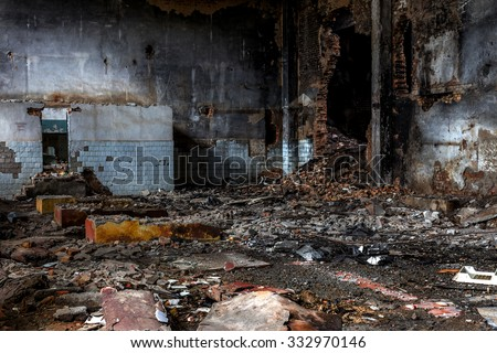 Landscape with the ruins of old industrial factory buildings. The interior of an abandoned factory with rubble plunder and waste. Collapse of economy.  Selective focus as background for design trash - stock photo