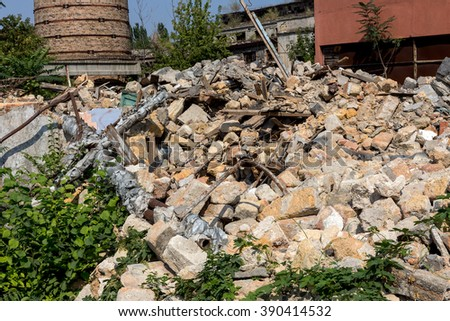 Landscape with the ruins of the old industrial factory buildings. The old industrial building after an earthquake. - stock photo