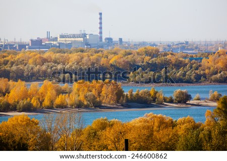 Landscape with trees and smoke stack - stock photo