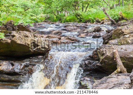Landscape with waterfall in the mountains, Scotland - stock photo