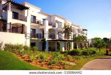 landscape with white holiday villas on summer resort(Algarve, Portugal) - stock photo
