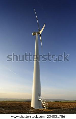 Landscape with wind turbine in Cadenbronn, Moselle, Lorraine, France, Europe - stock photo