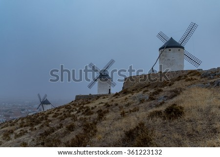 Landscape with windmills at the top of the hill in Spain - stock photo