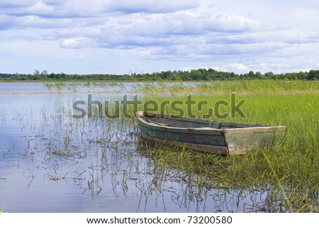 landscape with wooden boat on the river
