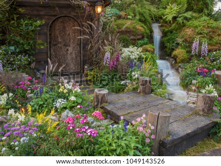 Landscaped backyard of old house with flower garden