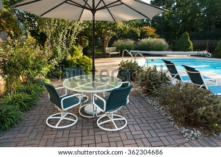 Landscaped Backyard Patio and Pool - stock photo