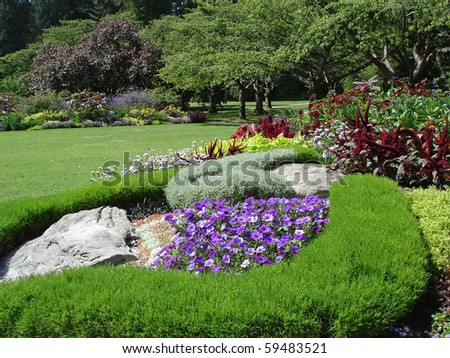 Landscaped flower garden, Stanley Park, One of the Largest Urban Park's in The World - Vancouver, BC, Canada - stock photo