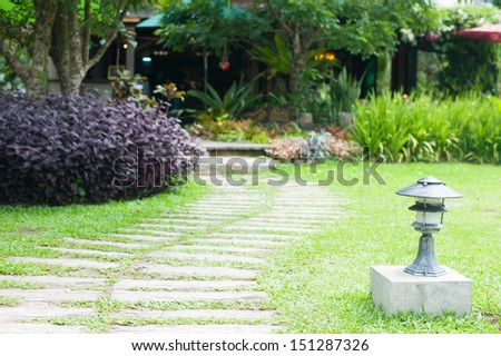 Landscaping in the garden. The path in the garden, shallow depth of field. - stock photo