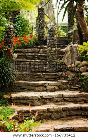 Landscaping in the garden. The path in the garden with pond in asian style - stock photo