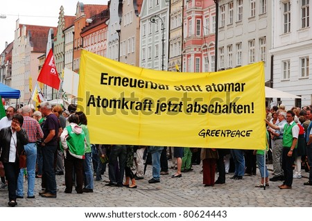 LANDSHUT, GERMANY-JUNE 11:Unidentified activist holds banners at a demonstration against nuclear power and pro renewable energy on June 11,2011 in Landshut, Germany