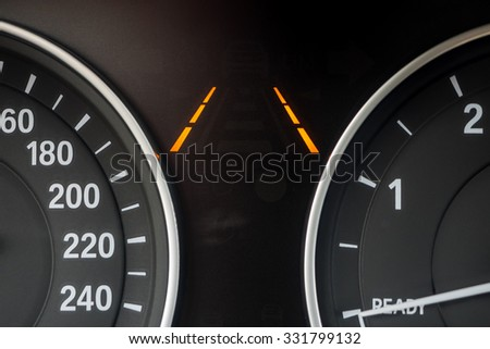 Lane keeping assist symbols on modern car instrument panel