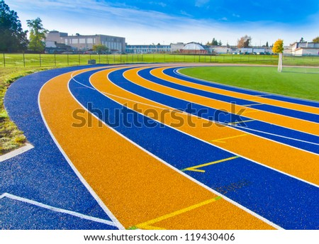 Lanes of a yellow and blue race track. - stock photo