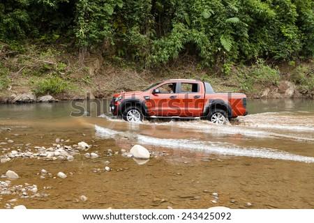 Lang Son, Viet Nam - Nov 4, 2014: Ford Ranger Wildtrak crossing river in Vietnam - stock photo