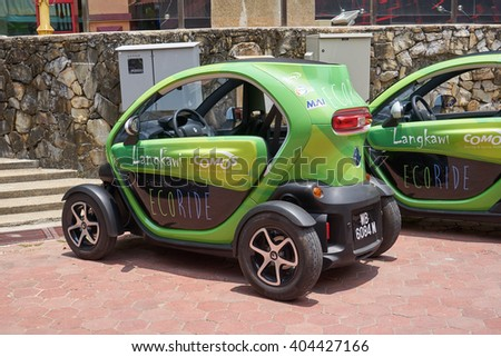 Langkawi, Malaysia - April 4, 2016: Tiny electric car Renault Twizy at the city street. - stock photo