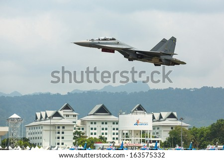 LANGKAWI, MALAYSIA - MAR 26: Su-30MKM (Sukhoi, NATO reporting name: Flanker-C) performing during on LIMA13 Langkawi International Maritime & Aerospace Exhibition on Mar 26, 2013 in Langkawi, Malaysia. - stock photo
