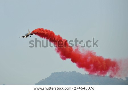 LANGKAWI, MALAYSIA - MARCH 18: UAE Aerobatic Team, Al Fursan display the show with Aermacchi MB-339 aircraft in LIMA 2015 at Langkawi Malaysia on 18 March, 2015 - stock photo