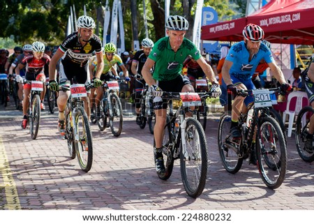 LANGKAWI, MALAYSIA - 15 OCTOBER 2014: Cyclists compete in theTradewinds LIMBC 2014 on October 15, 2014.  - stock photo