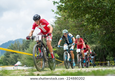 LANGKAWI, MALAYSIA - 18 OCTOBER 2014:  Sebastian Fini Cartensen(front) of Denmark National team in action at Tradewinds LIMBC 2014 on October 18, 2014.