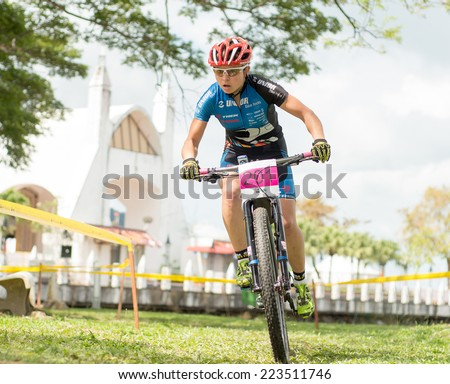 LANGKAWI, MALAYSIA - 13 OCTOBER 2014:  Tanja Zakelj of  Unior Tool Team in action during Prologue - Individual time trial at Tradewinds LIMBC 2014 on October 13, 2014.  - stock photo