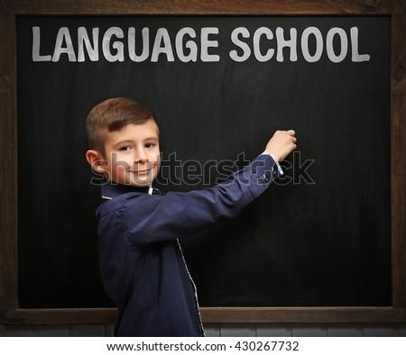 Language school concept with schoolboy - stock photo