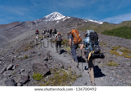 LANIN VOLCANO - JAN 4: John Doe climbers in the trail. With thousands of visitors every season, it is the most climbed mountain in Patagonia. Jan 4, 2013 in Lanin Volcano, Patagonia, Argentina. - stock photo