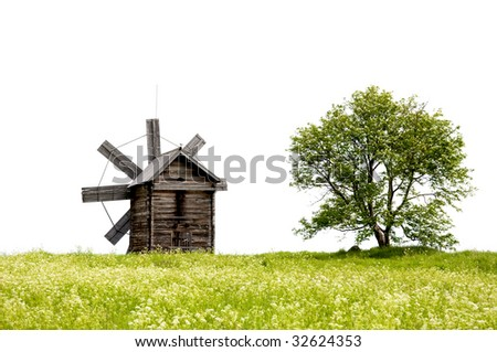 Lanscape with old windmills and a lonely tree - stock photo