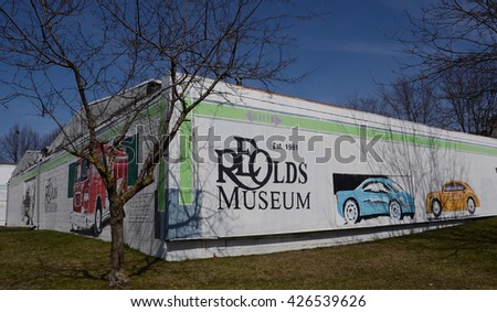 LANSING, MI - MARCH 27:  Lansing's Olds Transportation Museum, whose back mural is shown on March 27, 2016, is one of the top-rated automotive museums in the United States.  - stock photo