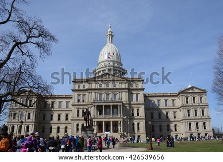 LANSING, MI - MARCH 27:  The Michigan State Capitol, hosted a visit by the Easter Bunny on March 27, 2016. - stock photo