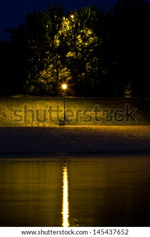 Lantern by the river at night, view from Ada island, Belgrade, Serbia - stock photo