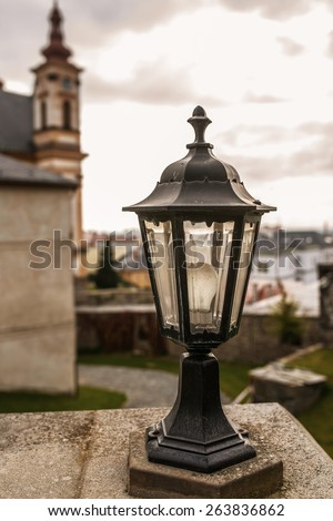 Lantern closeup about Church of Annunciation in Olomouc Region of Czech Republic. - stock photo