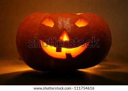 lantern, illuminating pumpkin in dark night - stock photo