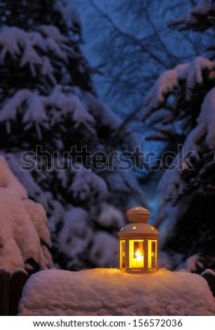 Lantern on snow - stock photo
