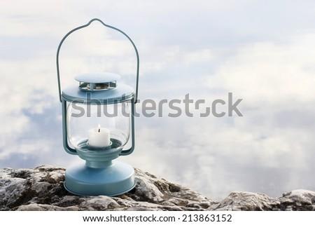 Lantern on the rock - stock photo